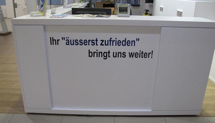 Arbeitsplatz Beschritung von Amag Schaffhausen mit Slogan